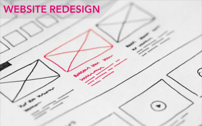 a pink sketch with pen and paper showing a website design structure remake