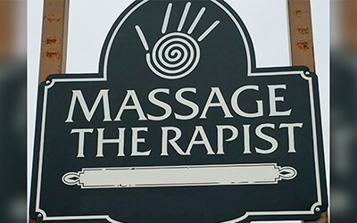 a sign showing a massage therapist logo but with bad letter kerning