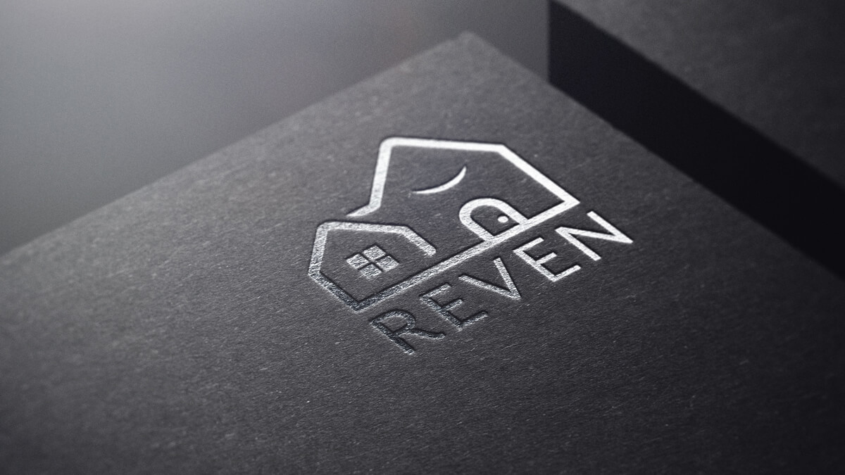 house and garage logo for Reven on a black mockup with silver plated graphic