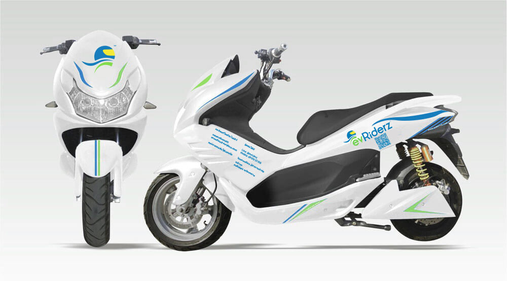 white eco-friendly motorbike in a photography studio with green and blue stickers