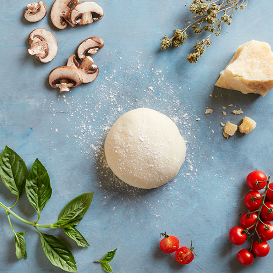 Fresh ingredients featuring one-of-a-kind pizza dough, Wild Italian oregano, grana padano cheese, and cherry tomatoes