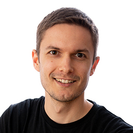 Risecore founder, Cody Monroe, in black shirt on white background