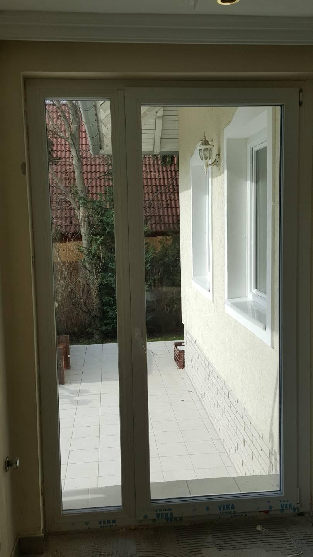 Családi ház ablak ajtó