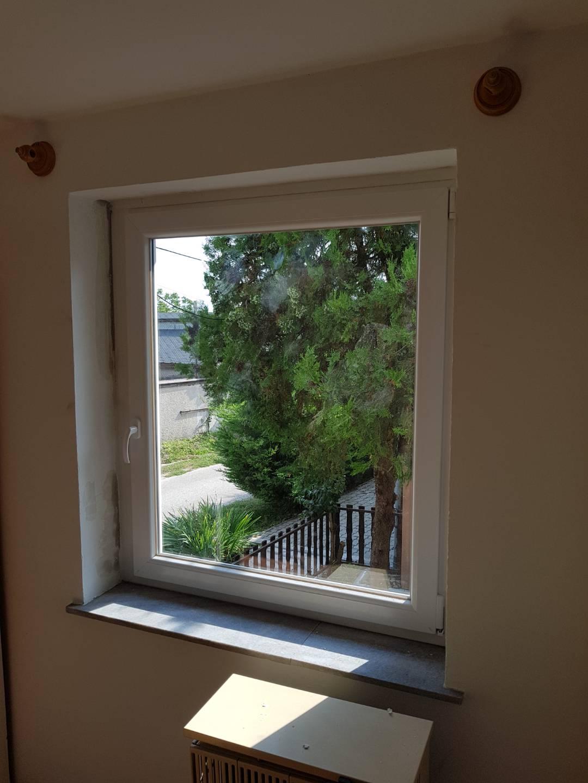 Fényes tégla lakás ablakcsere