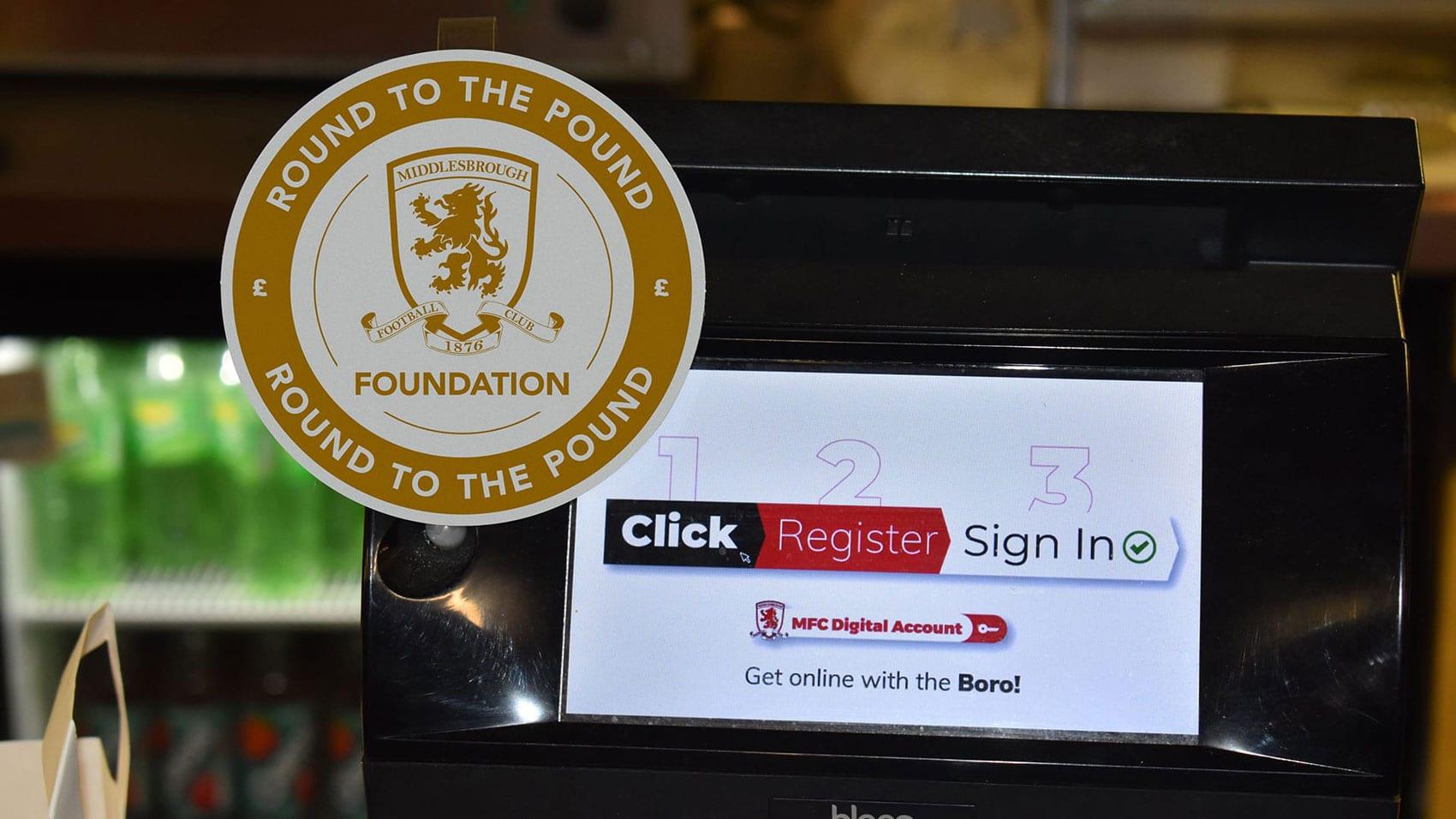 Round to the pound logo design on MFC Foundation, Middlesbrough Football Club Store, MFC Store tills checkout  - Riverside Stadium #boro #uptheboro