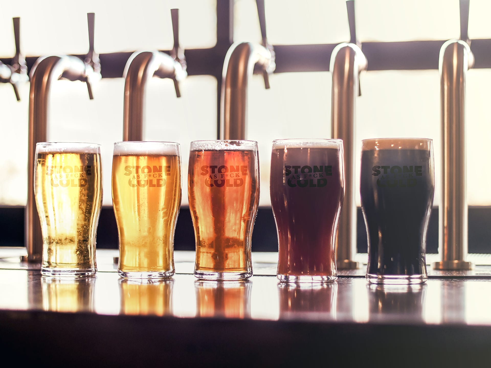 Stone Cold Alcohol Free Beer Pint Glasses - In front of Beer Taps