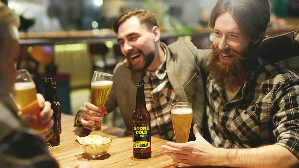 Stone Cold Alcohol Free Brewery - Male friends laughing and drinking beer