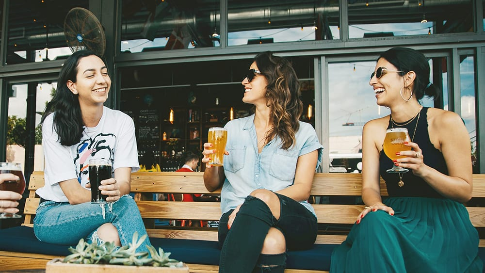 Stone Cold Alcohol Free Brewery - Female friends laughing and drinking beer