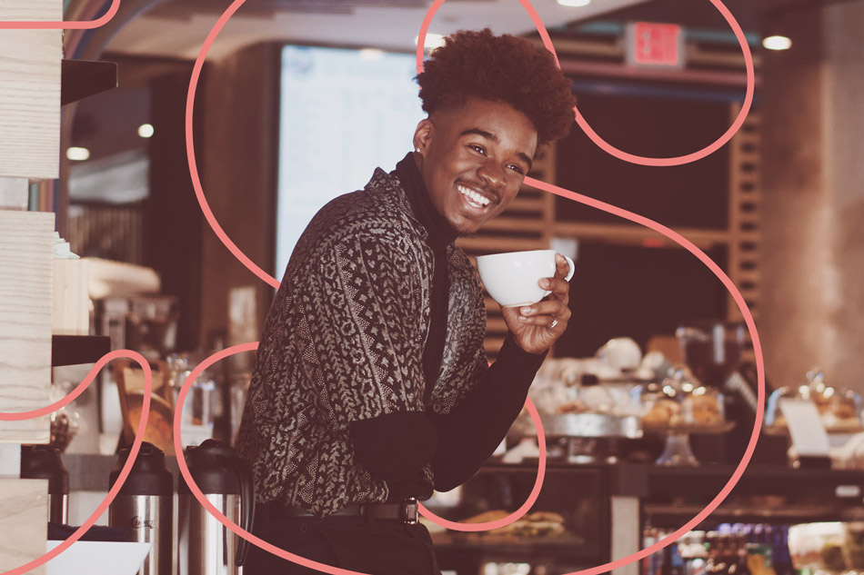 Black man cafe owner and barrister drinking a cup of coffee
