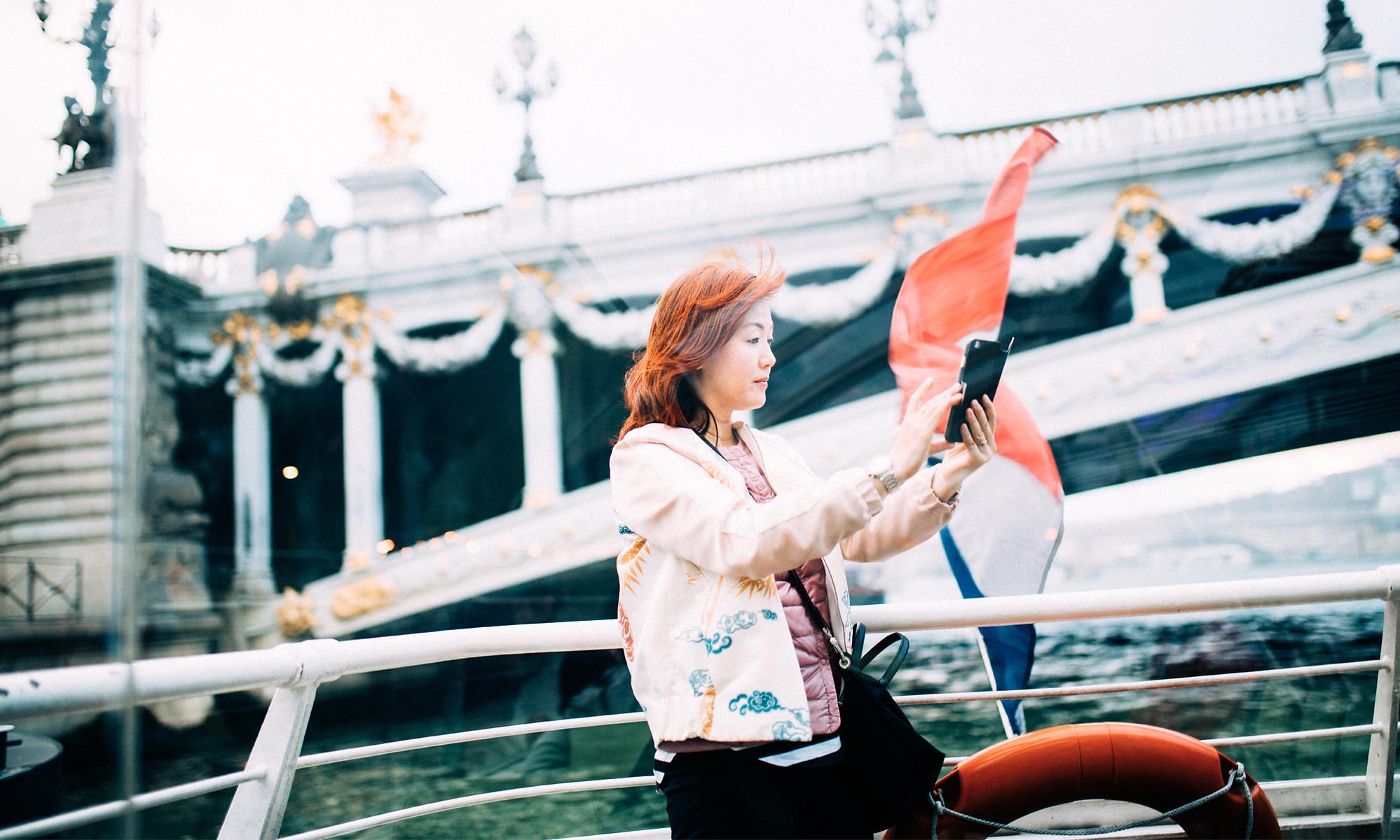 Paris girl holding phone