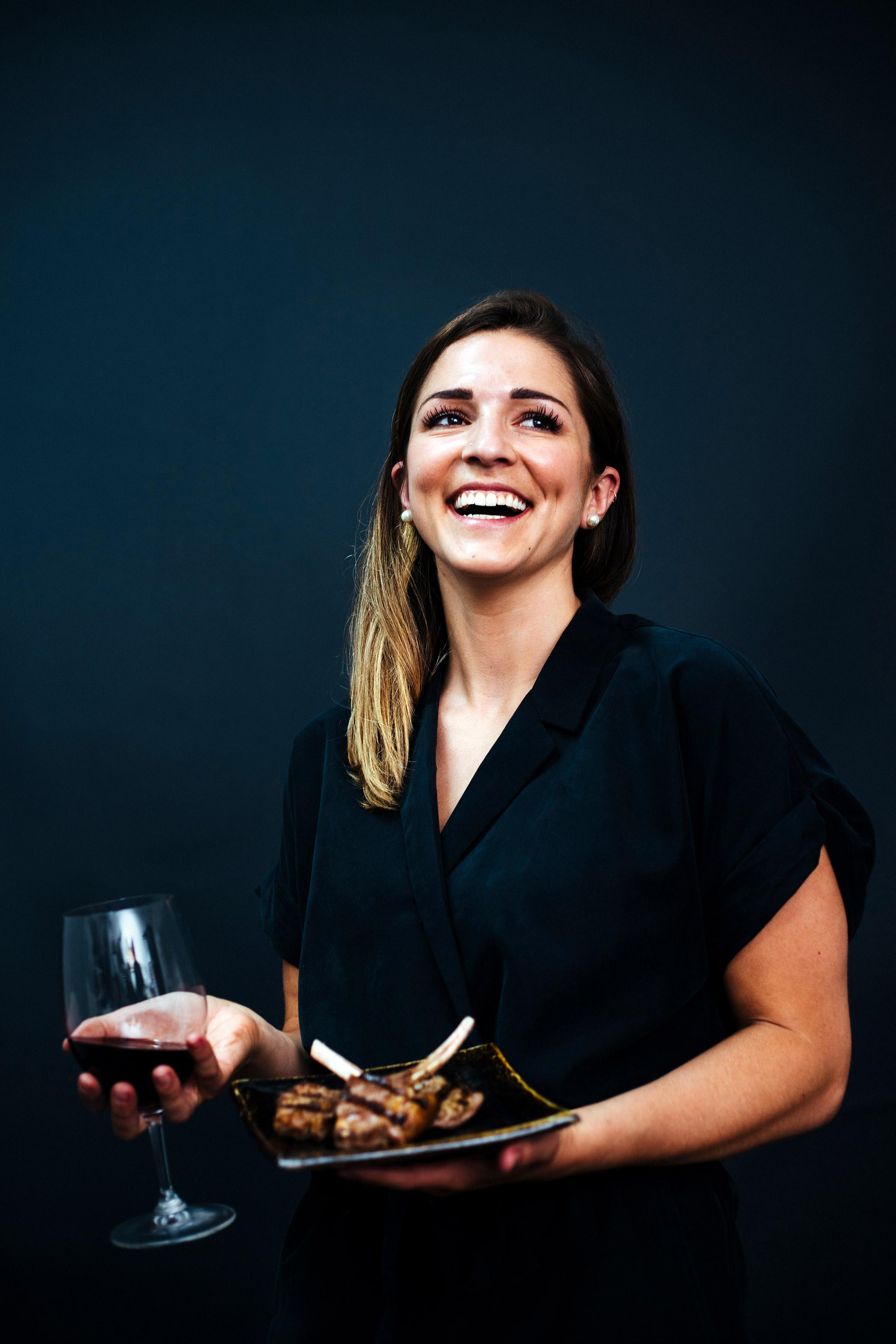 Girl holding wine & dish