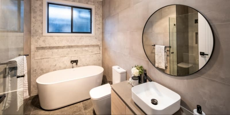 Main bathroom with free standing bath and black tapware