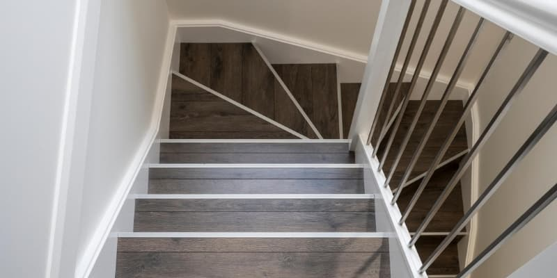 Staircase featuring hard wearing laminate flooring