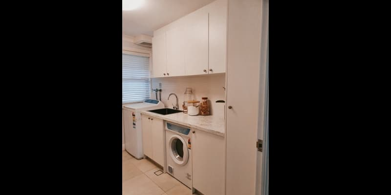 Spacious and full storage laundry room