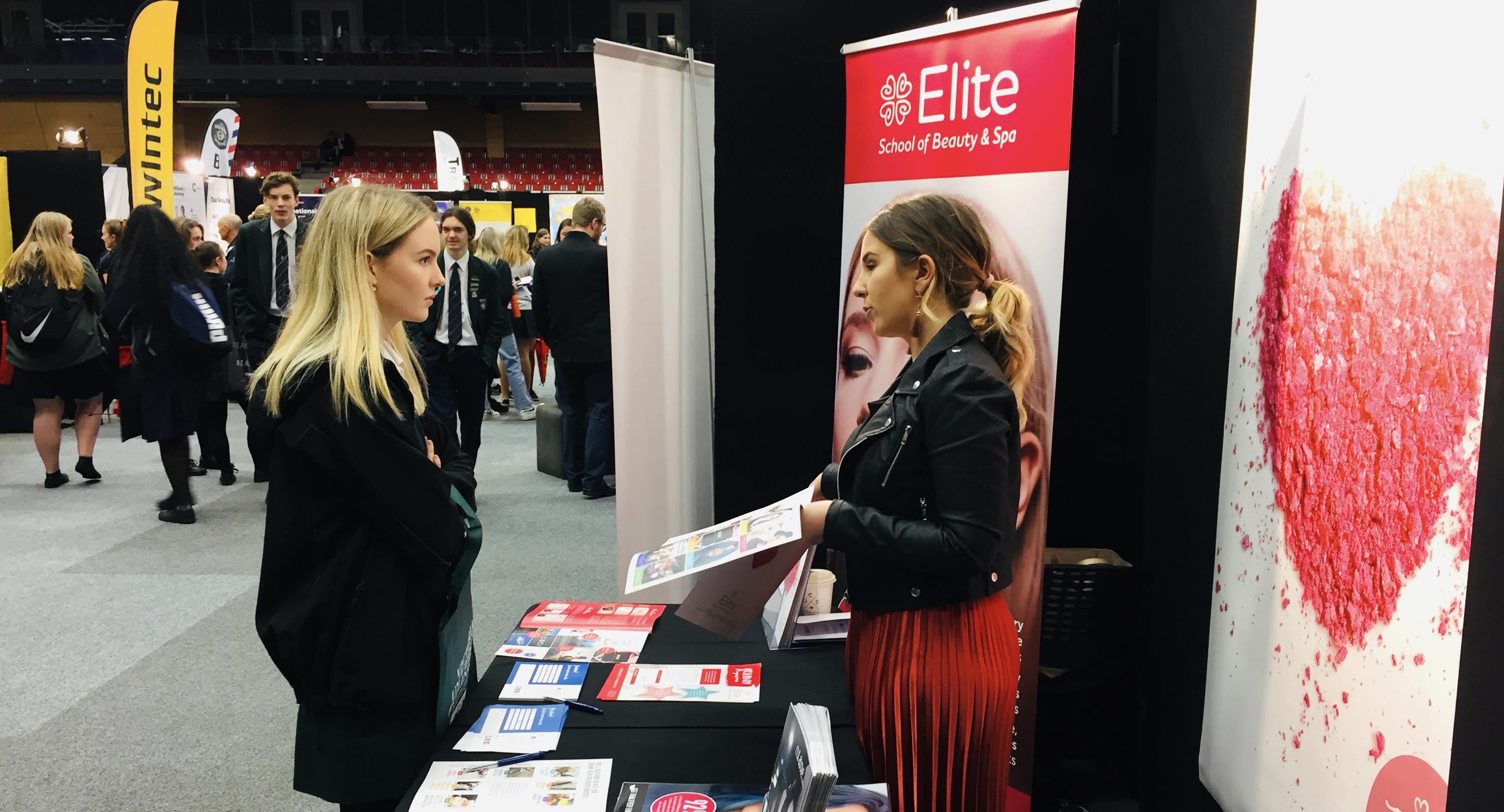 A student talks to a Career advisor at Canvas Careers Expo.