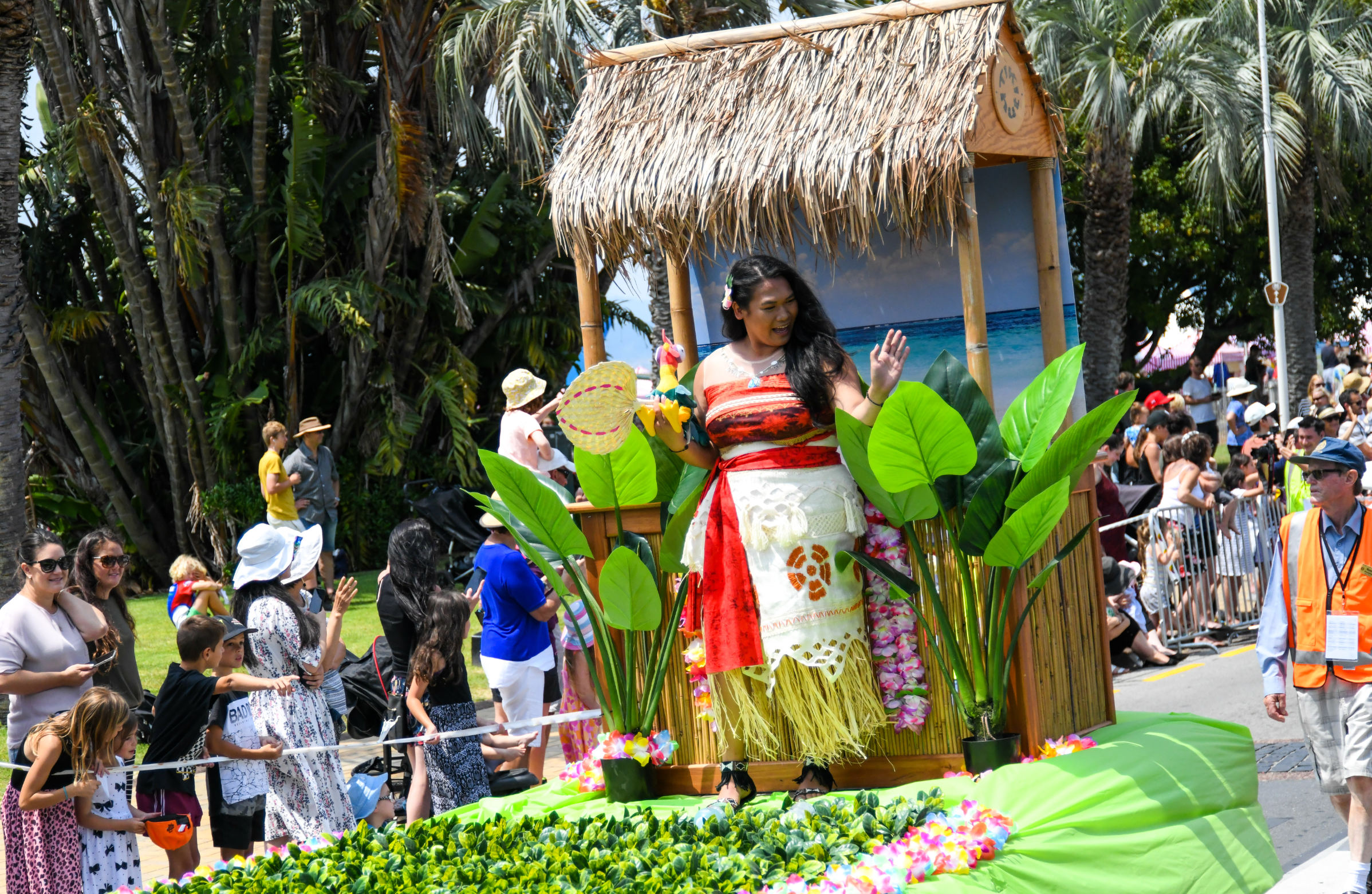 Moana on the float waving to spectators at the Downtown Tauranga Christmas Parade