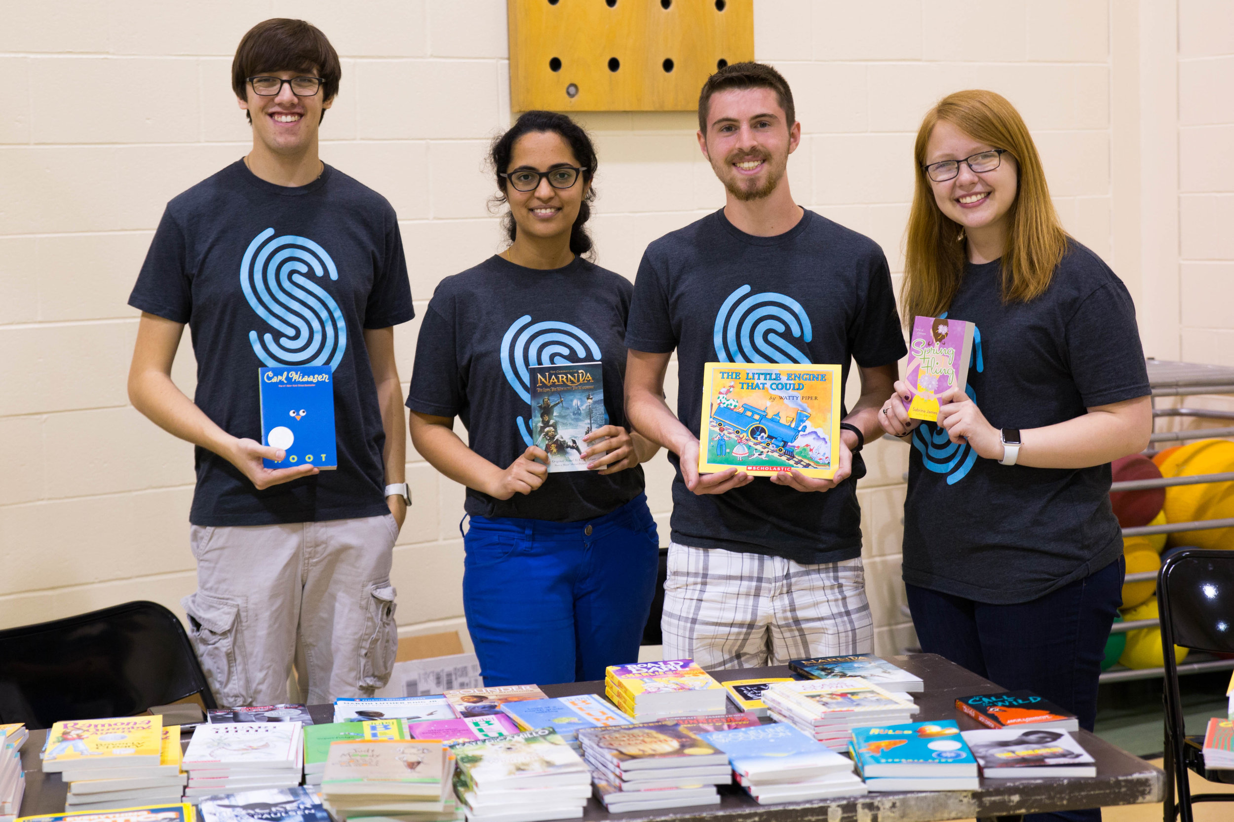 2017 interns host a book table during their intern-led community impact event, Read, Play, Go! This interactive event brought elementary students together with Spreetailers for a day of learning, creativity, and play. Spreetail donated books for the students to take home, plus new sports equipment shared with five area schools.