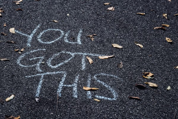 Chalk writing reads 'You got this'
