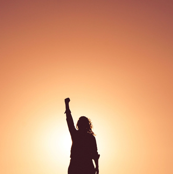 Woman raising left fist in the air