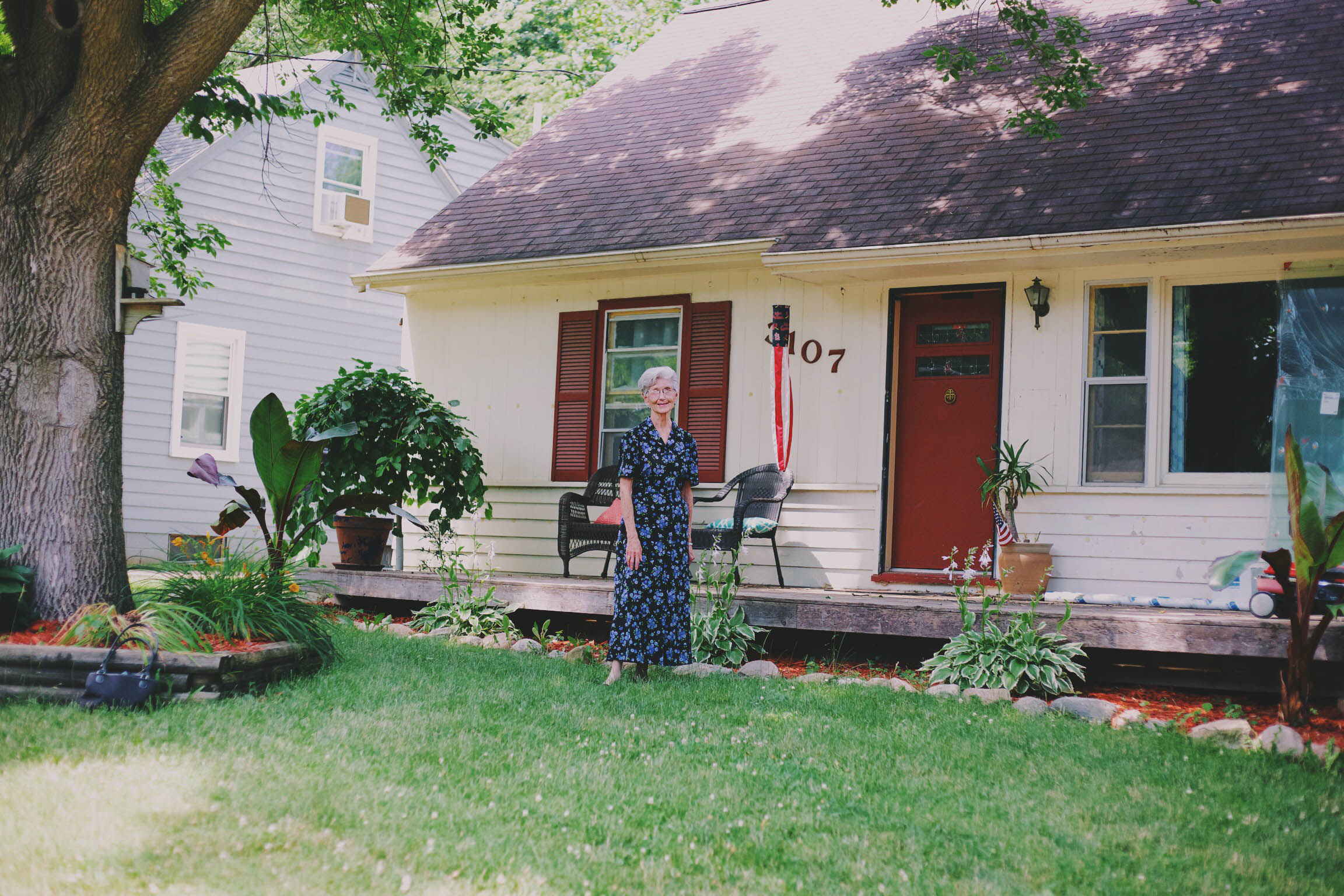 Jeanne poses in front of a house she used to live in