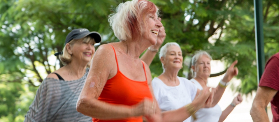 Elderly woman in group exercise class