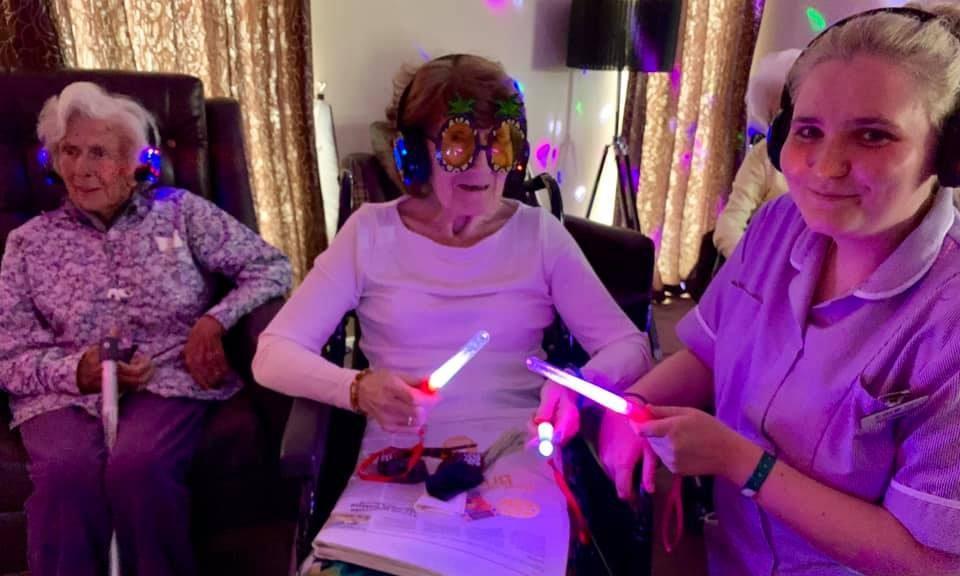 Photo of senior residents enjoying a silent disco
