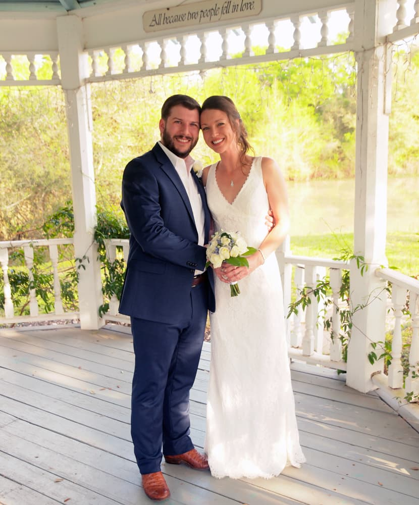 Bride and groom standing in the Lakeside Gazebo