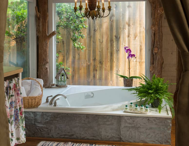 Large soaking tub in luxurious accommodations at BlissWood Ranch