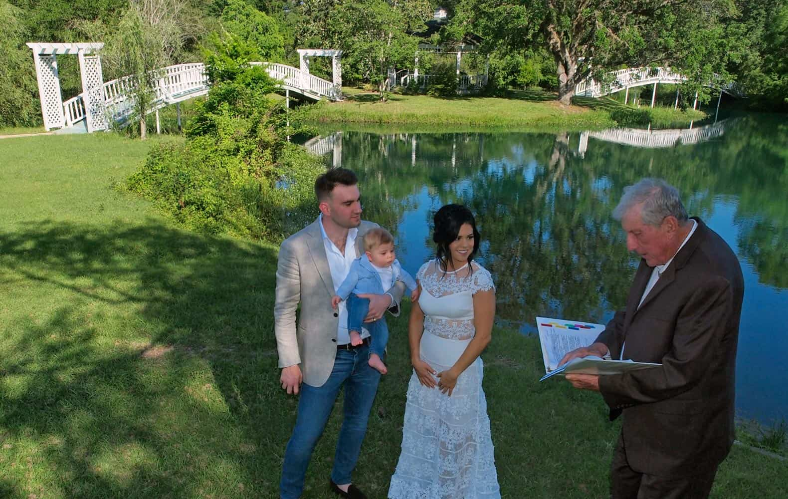A couple and a small child in a small wedding ceremony at our Texas wedding venue