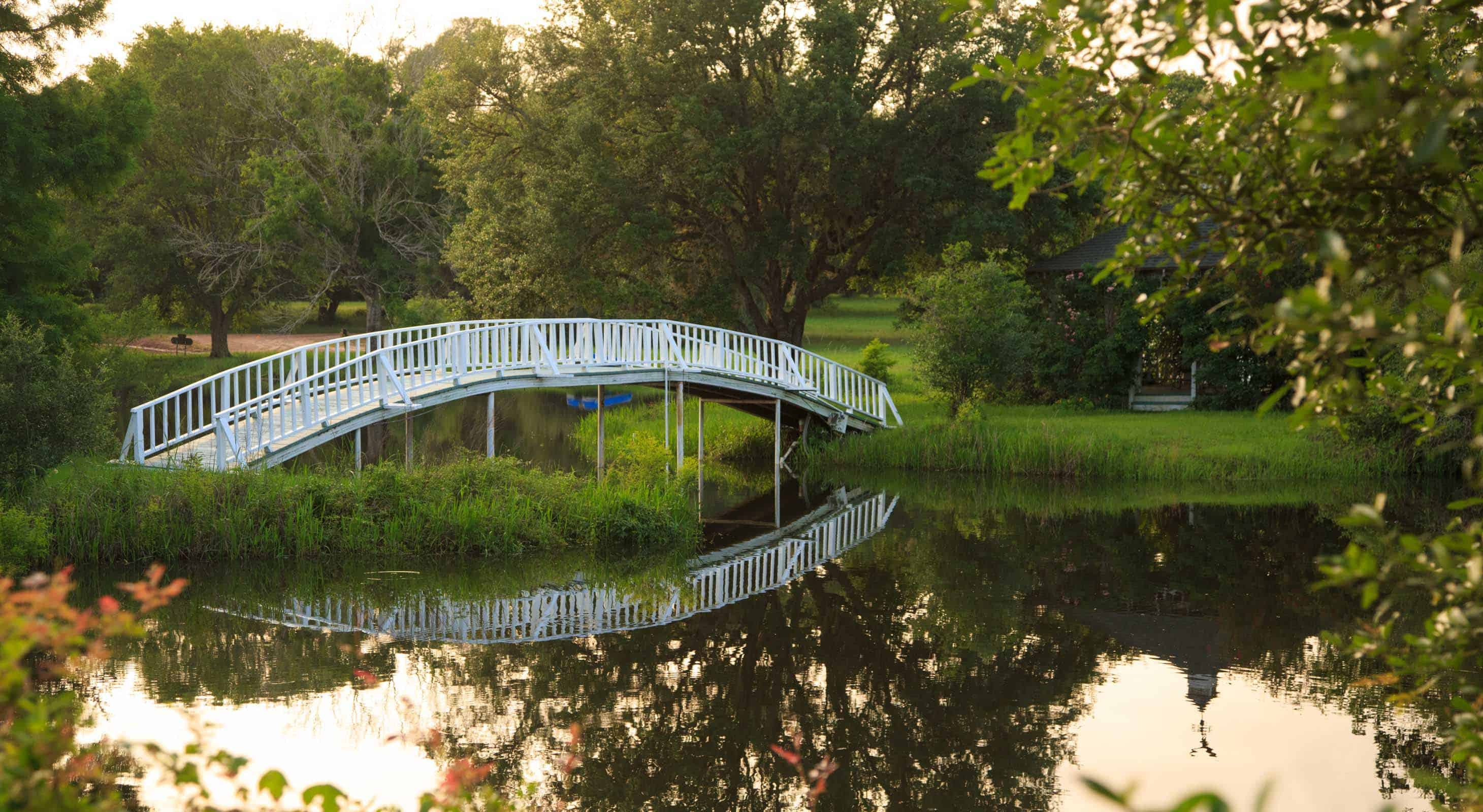 White arching bridge and gazebo at Blisswood Ranch