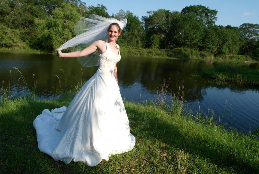 Bride and by the lake at BlissWood Ranch