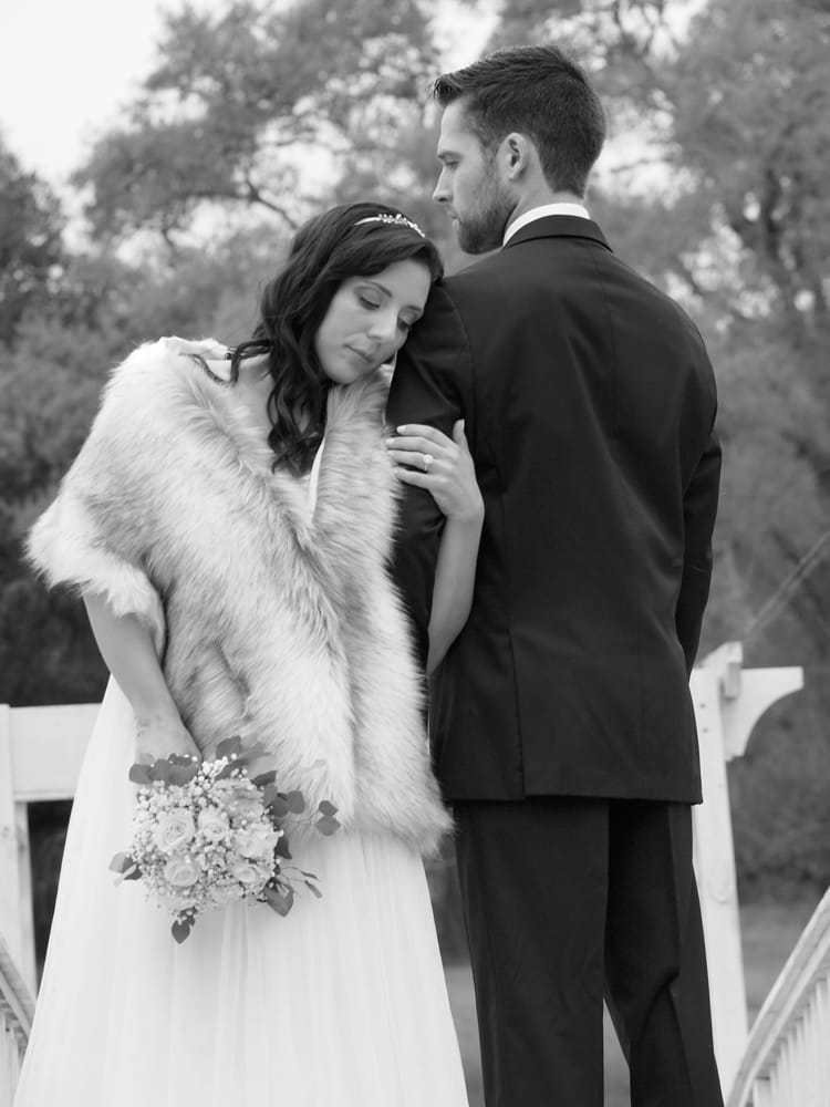 Black and white photo of bride and groom in a tender moment