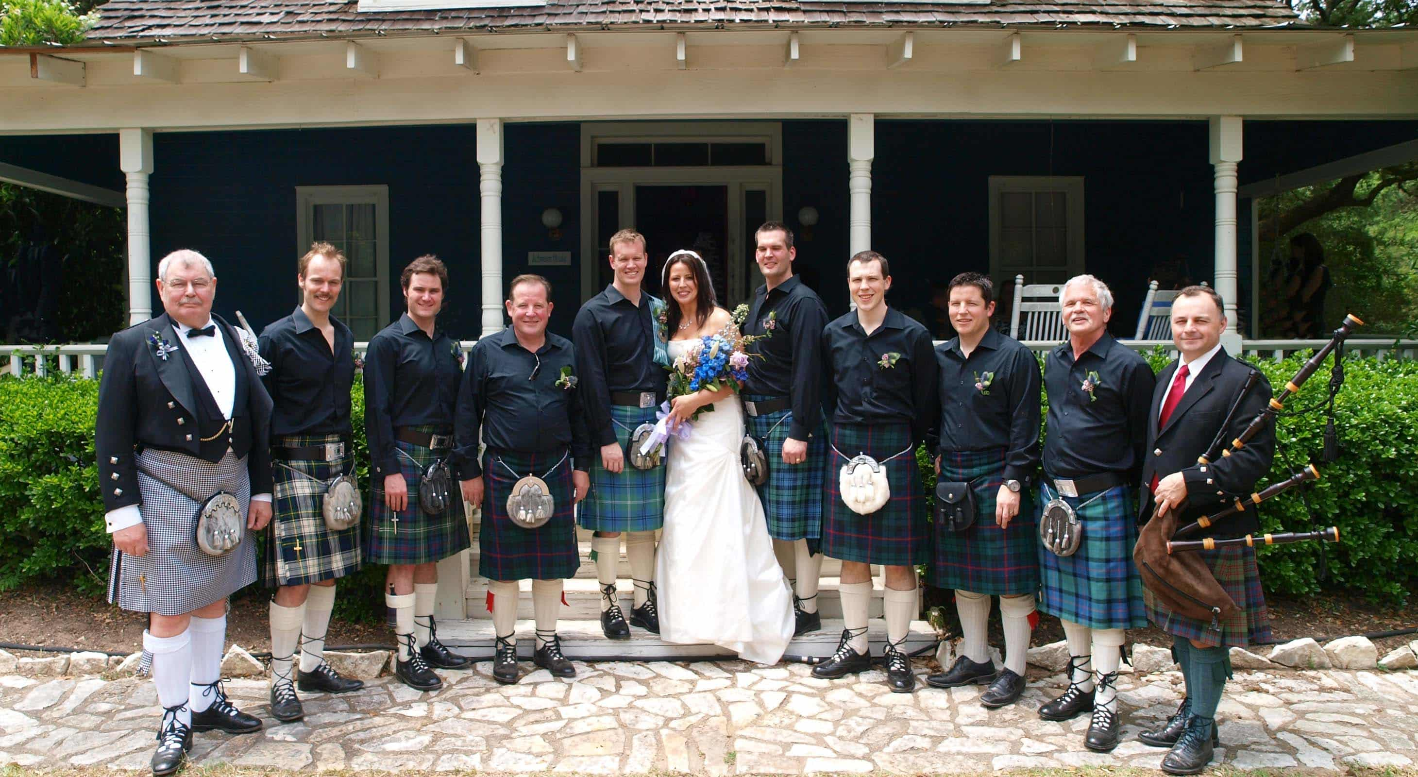 A large wedding party in traditional Scottish attire at BlissWood Ranch