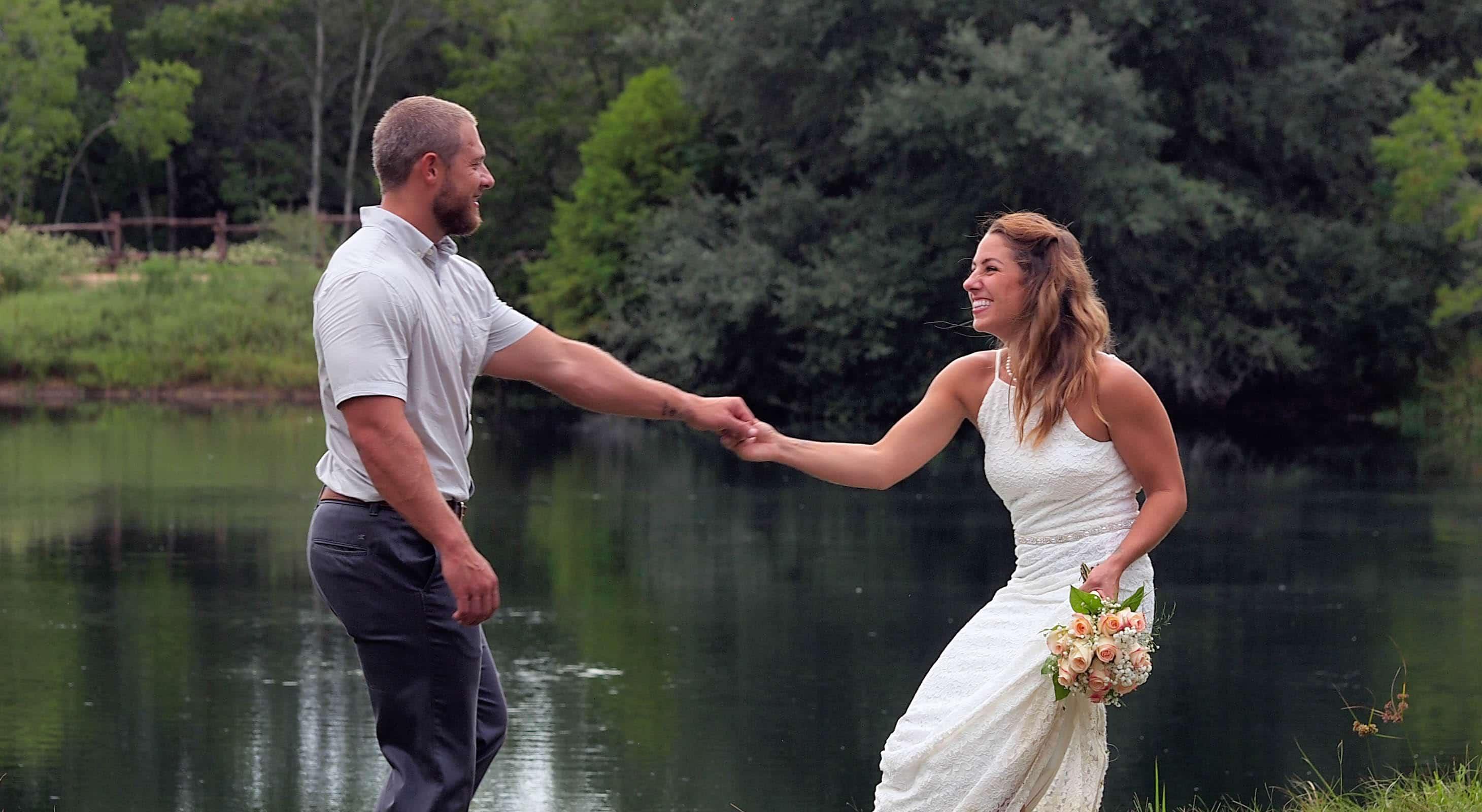A couple joyfully holding hands
