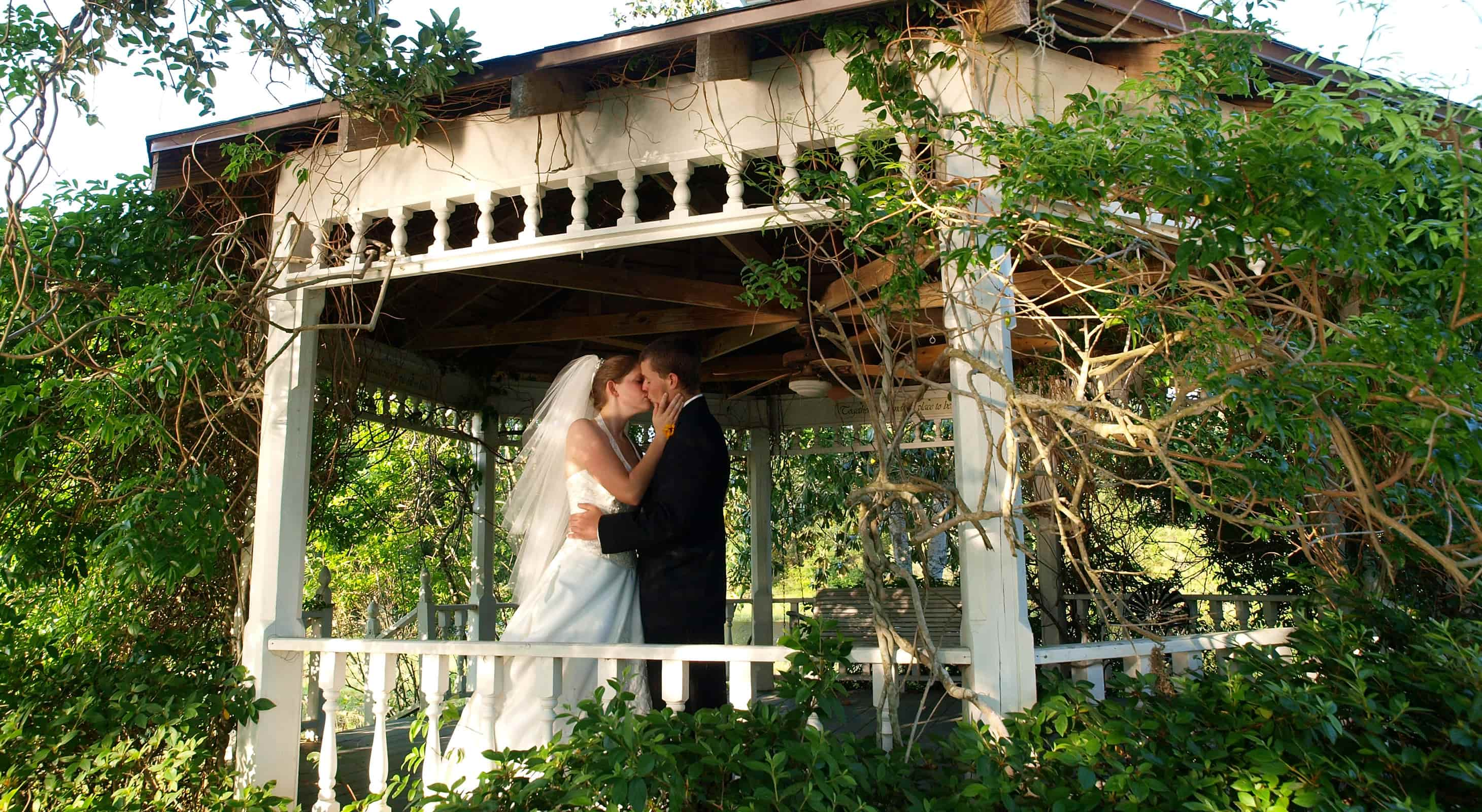 Romantic elopements in our Gazebo at Enchanted lake with a Texas elopement package