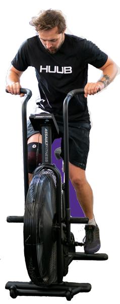 man training on assault bike