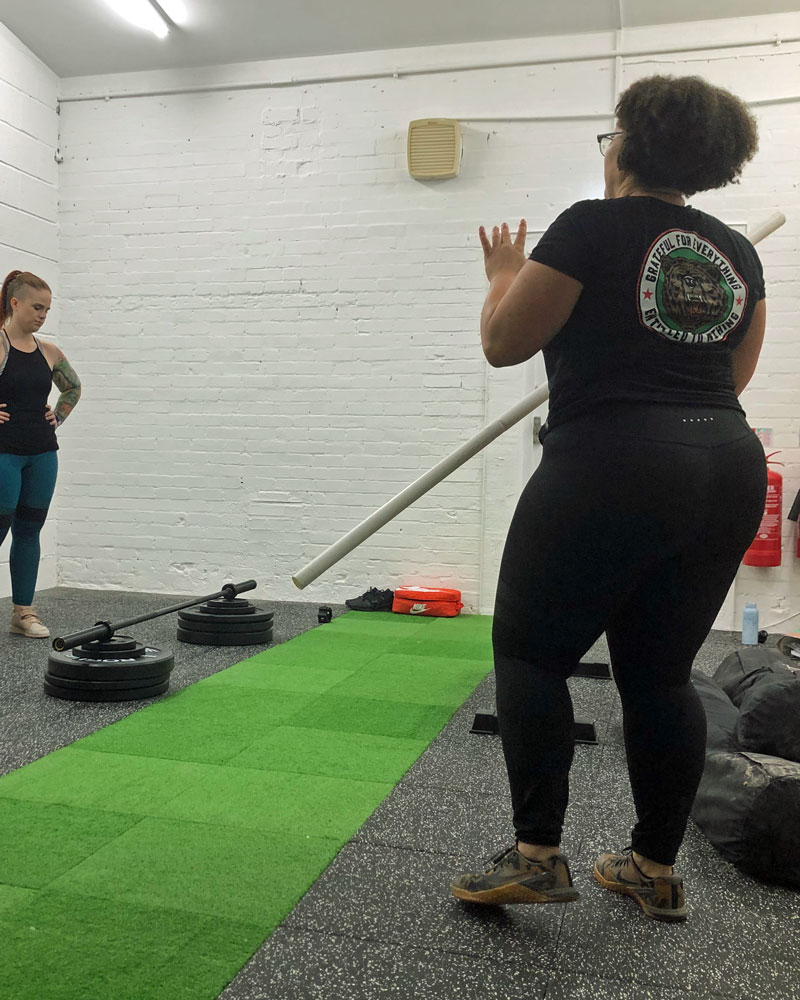 Client laughs with personal trainer