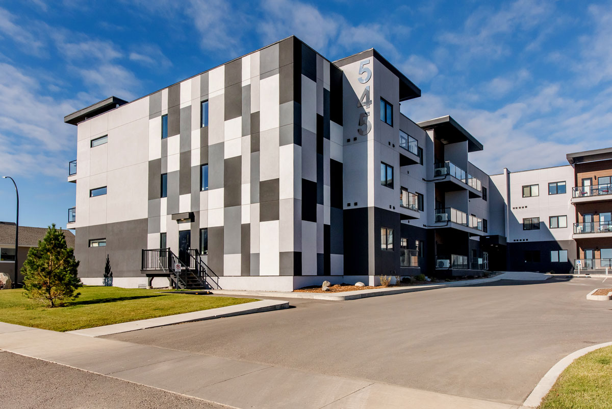 Kensington Flats apartments in Saskatoon, Sask. The siding is checkered black, white and grey.