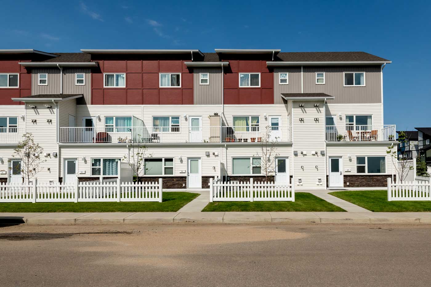 A view of the Cory Villas townhouses in Saskatoon, Sask., that shows the semi-private yard on the two-bedroom suites.