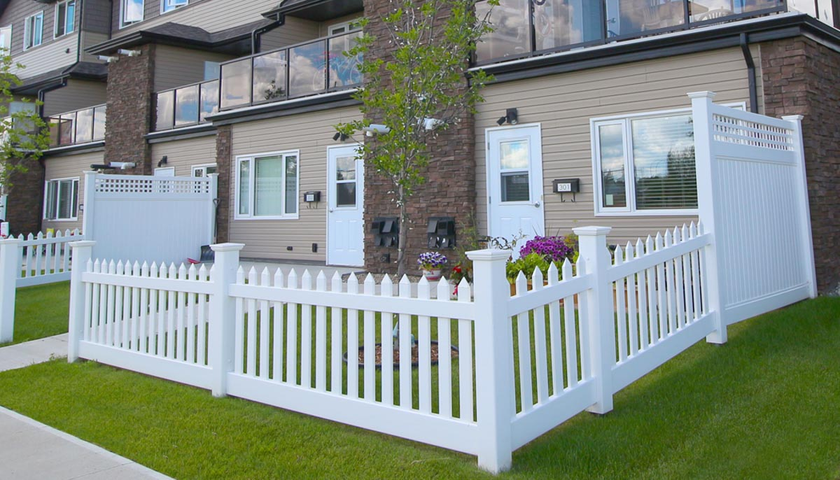 A view of the entrance to the two bedroom suites at the Hardford Heights townhouses in Saskatoon, Sask. There is a semi-private yard with a white picket fence.