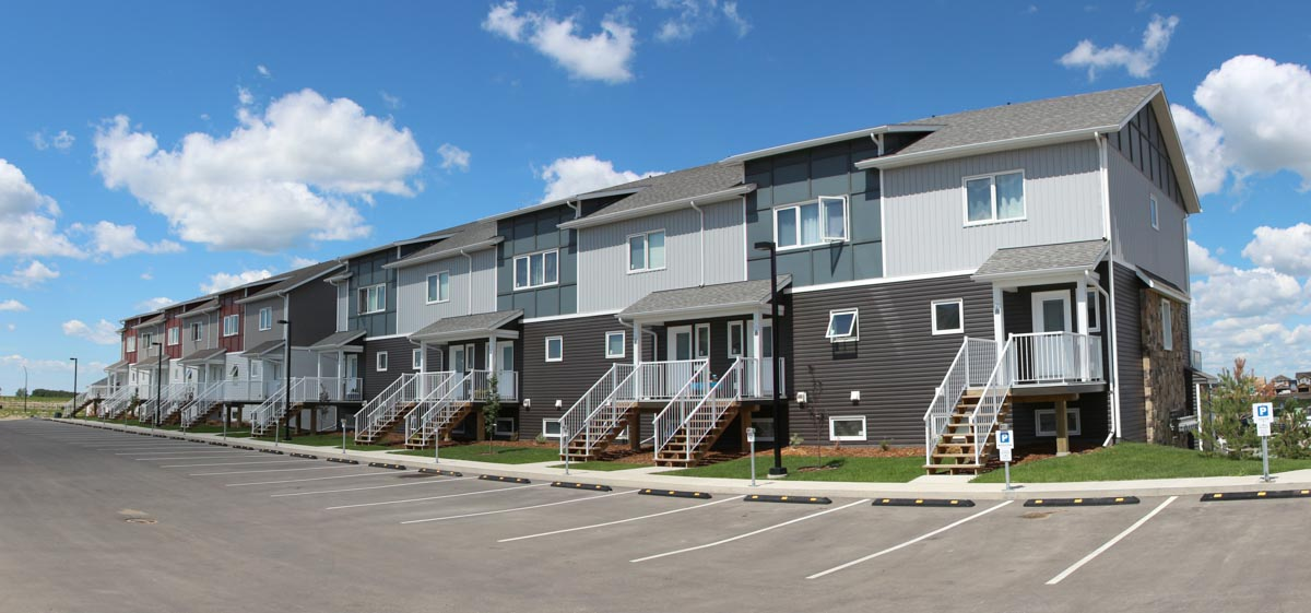 Kensington Estates townhouses in Saskatoon, Sask. The siding is Blue, dark grey, and light grey.
