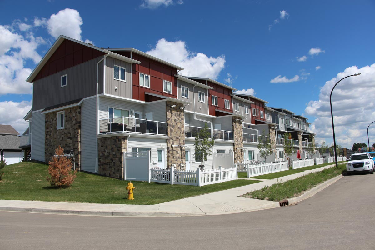 A view of the Kensington Estates townhouses in Saskatoon, Sask., that shows the semi-private yard on the two-bedroom suites.
