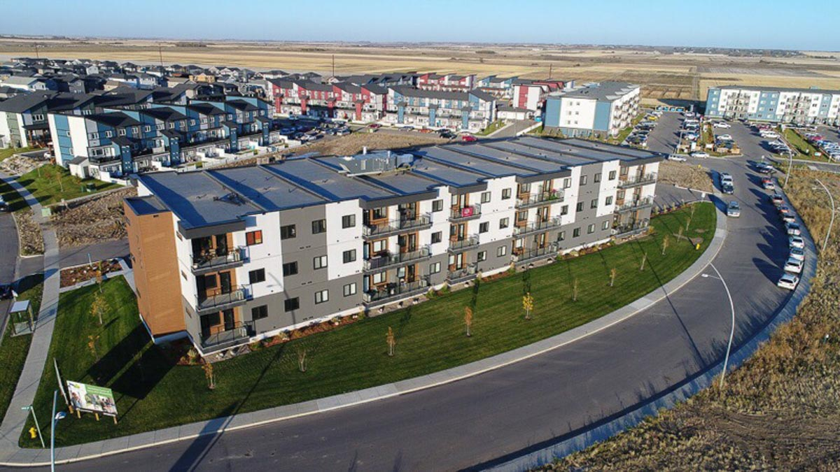 A photo from above of the Urban Flats 1 apartments in Saskatoon, Sask. You can see farmers' fields in the distance.