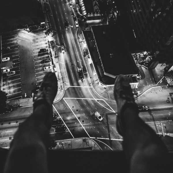 Man standing above the busy city streets