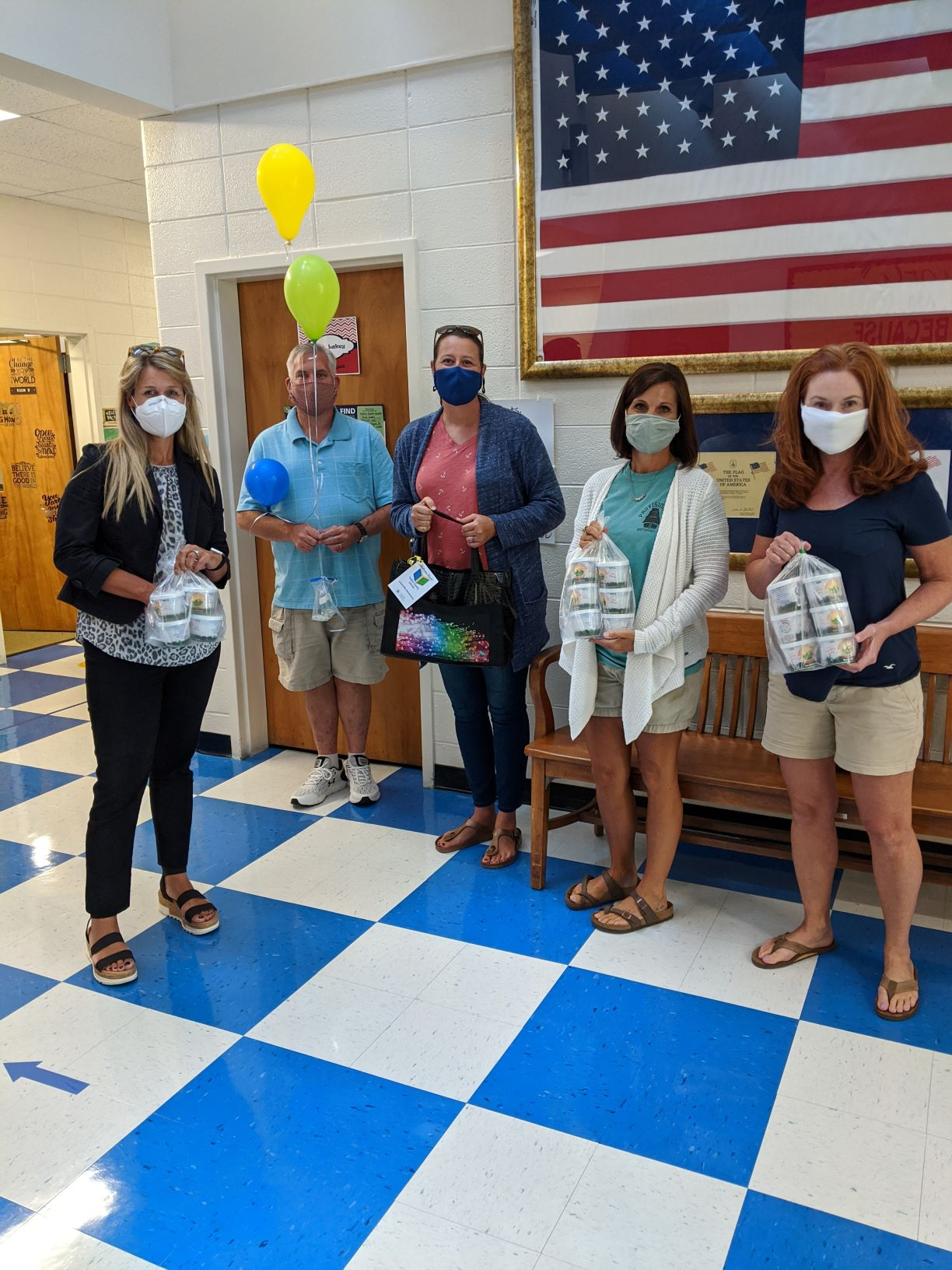 Staff gather with volunteers at Jonesville Elementary in Yadkin County