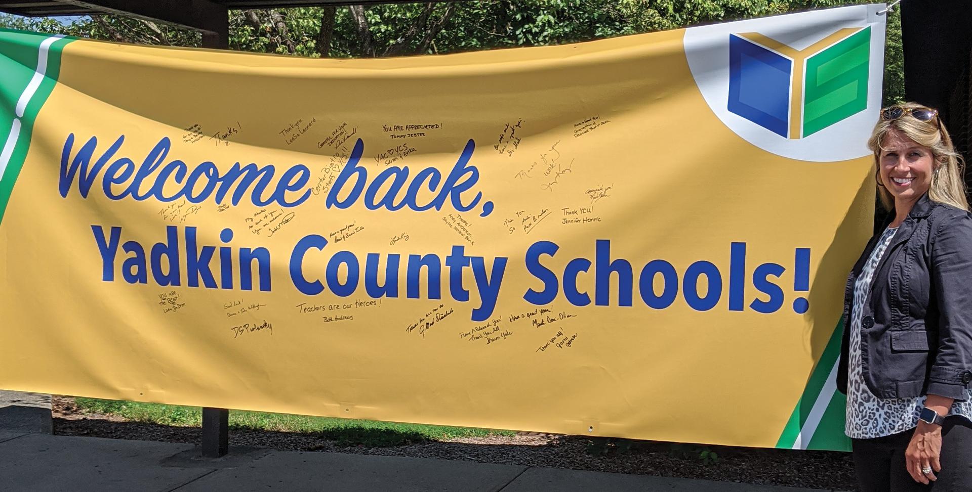 Welcome Back Yadkin County Schools banner on display.