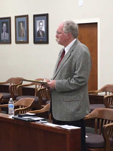 Dr. Wayne C. Matthews standing at a meeting in Yadkin County