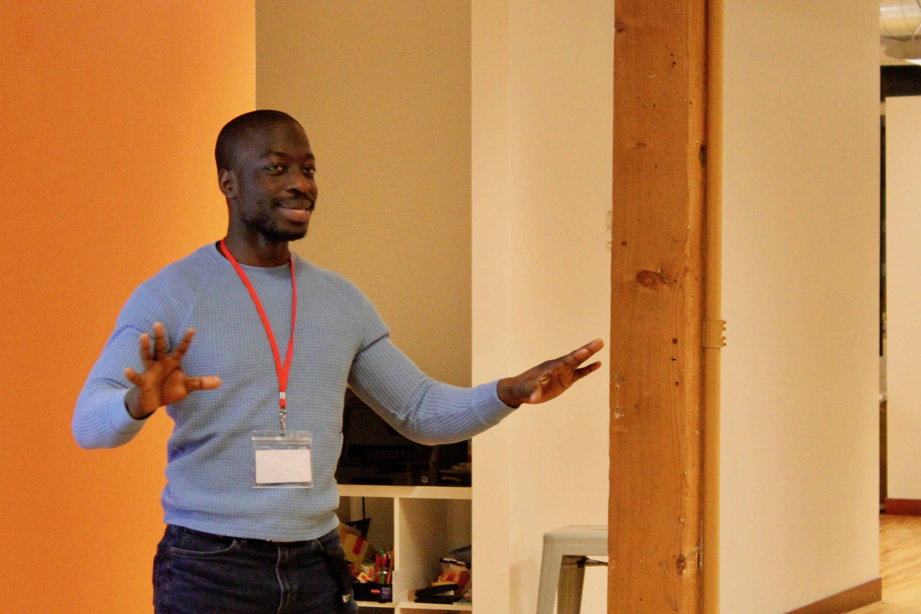 Baba Ajayi, Founder of SmoothAI, pitching at Upside's Winter 2020 Quarterly event