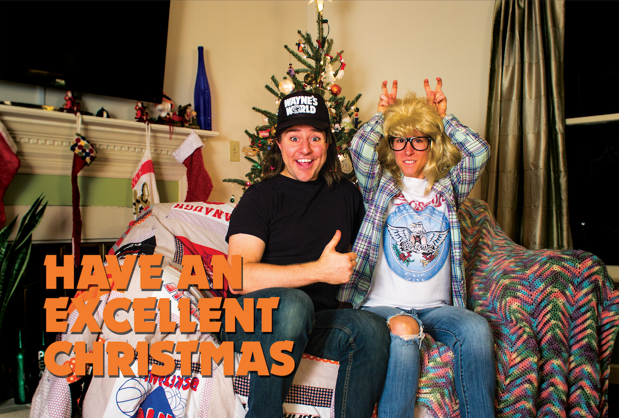Kyle and Ali dressed as Wayne and Garth from Wayne's World. Have an excellent Christmas.