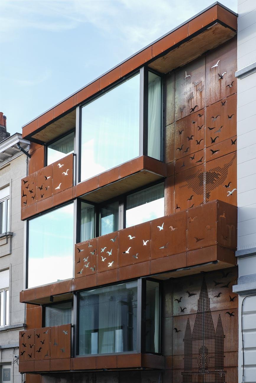 The Mansion Hotel Gent CLT gebouw met corten staal voorgevel het blauwe vogel Maeterlinck